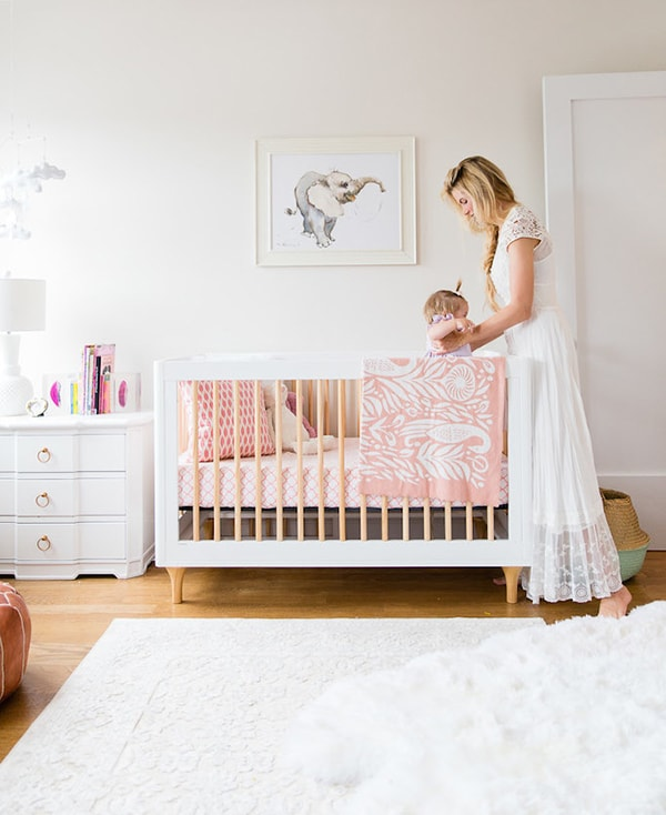 white nursery with pink accents
