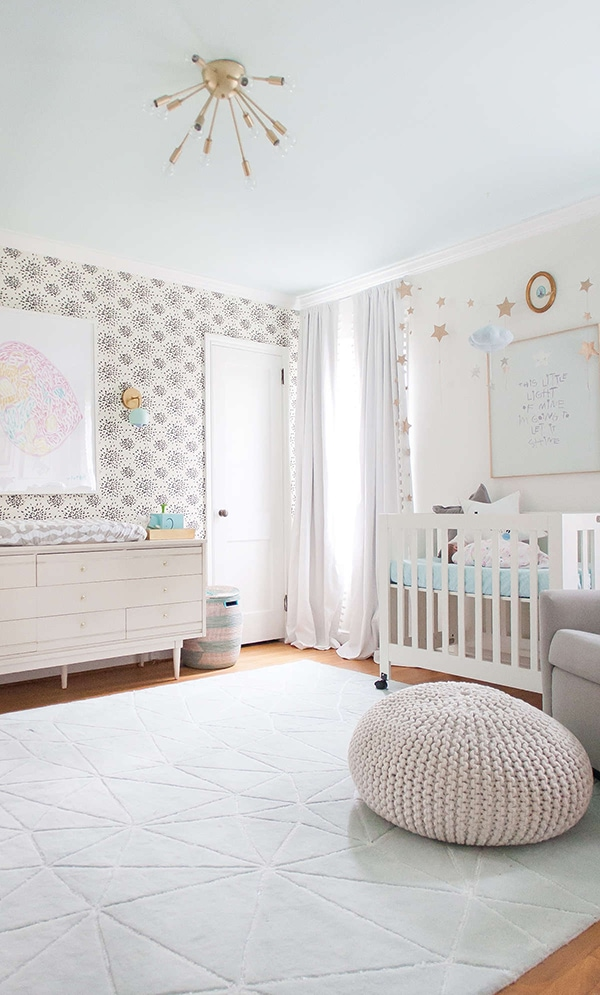 whites and grays with wallpaper nursery